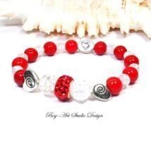 Korall karkötő hegyikristály gyöngyökkel piros medállal